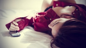 girl-on-bed-waiting-for-phone-call